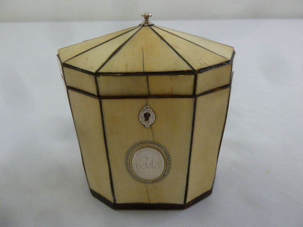 Lot 296 - A George III ivory octagonal tea caddy with applied silver cartouche, escutcheon and finial to