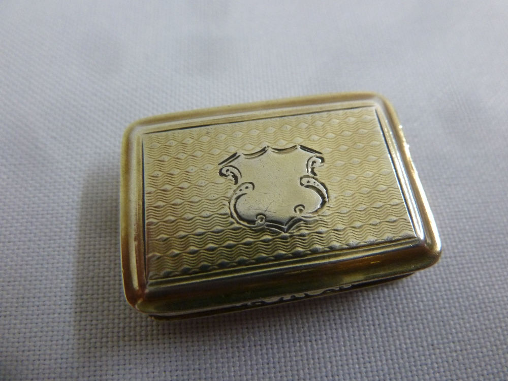 Lot 350 - Nathaniel Mills a rectangular engine turned silver vinaigrette, the hinged cover opening to reveal a