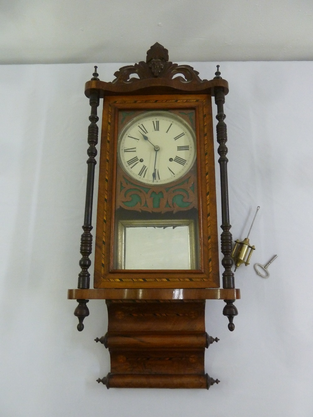 Lot 399 - A mahogany inlaid wall regulator to include key and pendulum