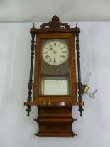 Lot 399 - A mahogany inlaid wall regulator to include key and pendulum