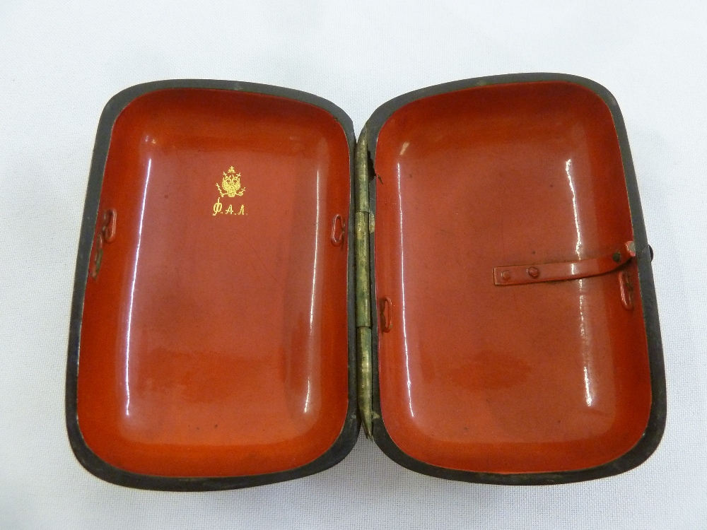 Lot 292 - A Russian papier mache cigarette box rounded rectangular the hinged cover depicting a soldier and
