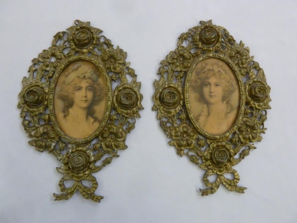Lot 221 - A pair of gilt metal decorative photograph frames