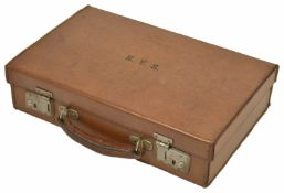 A delightful miniature tan leather travelling document case 20th century the lid opening up to