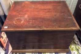 An oak trunk, 19th century of rectangular form with hinged lid above tongue and groove joined
