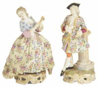 A pair of Continental porcelain figurines, early 20th century the lady holding a fan dressed in a