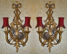 A pair of gilt wood Chippendale style twin branch wall sconces the wall mount with pierced ribbon