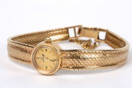 A ladies 9ct gold wind mechanism Omega bracelet watch, circa 1960 The small circular dial with baton