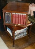 A mahogany revolving bookcase, mid 20th century the square top with four sections to hold books