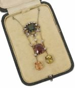 An attractive and unusual belle ?poque diamond and gem set scroll pendant necklace the centre set