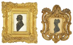 A 19th century silhouette miniature portrait of a Gentleman signed to reverse Capt. Hollamby, in a