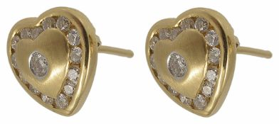 A pair of small contemporary heart shaped diamond set earrings with small central diamond and a