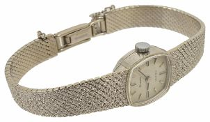 A 9ct white gold Bulova ladies bracelet wristwatch winding mechanism, the squared dial with baton