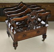 A Victorian mahogany Canterbury of typical form with three sections, each with pierced carved