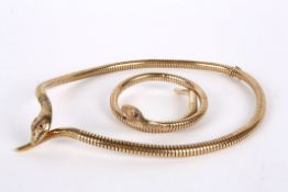 A gold articulated Victorian style snake necklace and matching bangle marked for 9ct gold and with