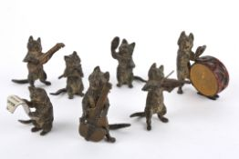 An Austrian cold painted bronze Cat Band, 20th century the seven cat figures each playing a