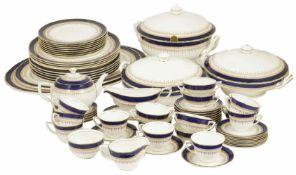 A Royal Worcester Regency pattern tea/dinner service with blue and gilt banded decoration,