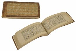 An interesting woven cloth and leather bound Islamic book The pages with Kufic script written in