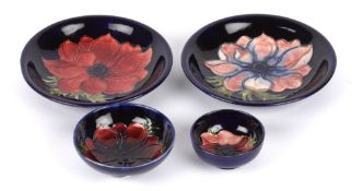 A pair of William Moorcroft Anemone pattern tube lined dishes, 20th century, of circular dished form