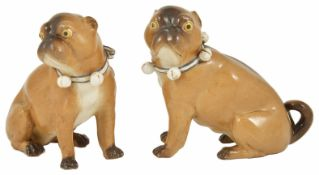 A pair of porcelain Pug Dogs, 19th century each in a seated position, with tan and brown coats, with