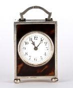An Edwardian silver and tortoiseshell carriage clock, London 1918 of rectangular form with French