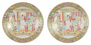 A pair of late 19th century Chinese famille rose plates each with central scene depicting