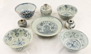 A collection of Chinese Swatow Ming dynasty blue and white pottery to include four scroll painted