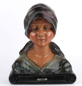 A French Art Deco bust of a female, 1930's wearing a headscarf, and shawl, upon a scroll incised
