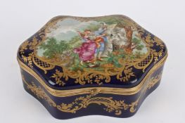 A Svres porcelain casket, 20th century of shaped form with hinged cover painted with central
