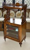 A Victorian walnut pierced music stand of rectangular form with pierced raised gallery rail upon