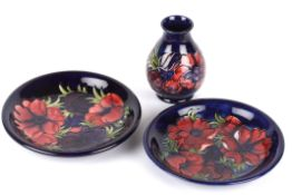 A pair of William Moorcroft Amemone pattern tube lined plates, circa 1994 of circular form with