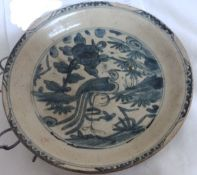 A Chinese blue and white Swatow crackle glazed plate, late Ming 16th/17th Century the centre painted