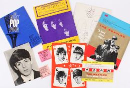 An interesting collection of five Beatles programmes together with three tickets and one photograph,