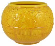 A Burmantoft's faience bowl, early 20th century of circular form with floral embossed decoration