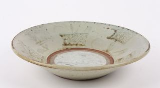 An 18th Century Chinese Swatow pale Celadon pottery dish the raised edge painted with planted