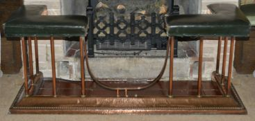 A copper and upholstered fire fender, early 20th century of typical form with upholstered leather