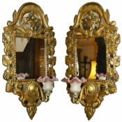 A gilt wooden sectional mirror wall light, 20th century the domed top with basket of fruit carving