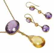 An attractive amethyst and yellow gem drop pendant necklace and earrings with central, side set