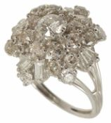A large contemporary diamond set floral cluster dress ring the central diamond approx. 0.50ct,