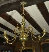 Dutch style brass six branch candle chandelier, early 20th century the central tapering baluster