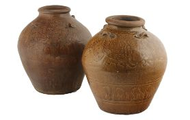Two large Chinese late Ming Swatow stoneware, yellow glazed wine jars The ovoid shaped jars with