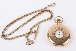 An antique 9ct gold Waltham gentleman's half hunter pocket watch on 9ct gold chain the case