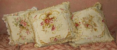 Four matching cushions made from 18th century Aubusson floral tapestry of rose and ribbon design (4)