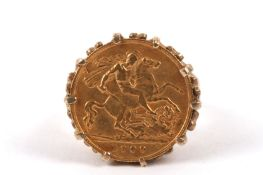 A 1909 fine gold half sovereign set in a 9ct gold gentleman's ring mount size R/S Weight approx.