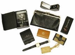 A collection of Gucci and other designer leather and other items to include a black leather Gucci