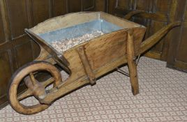 A French fruit wood wheelbarrow, late 19th century of typical form with rectangular section
