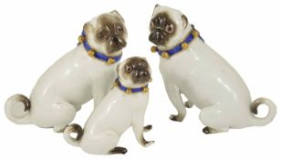 A pair of Meissen porcelain Pug Dogs, 19th century each in a seated position, with white body, faces