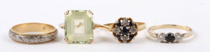 A large pale green rectangular cut gem set dress ring yellow metal mount (tests for gold), a