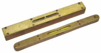 Two late 19th century brass and oak spirit levels one with makers name (worn) Marples & Sons the