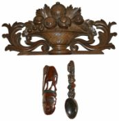 A tribal wooden spoon wall hanging, 20th century together with a Modern tribal wooden elephant and