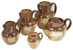 A series of Royal Doulton Jugs with teapot the four graduated jugs with figural and windmill applied